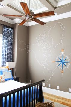 Nautical Boys Room. Compass and map hand painted on wall, modern beach theme. Blues, oranges, white, and tans. theraggedwren.blogspot.com