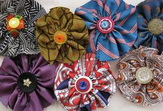 Recycled neckties made into cute little flower brooch.  Great way to add a little color to any outfit.