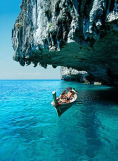 the water is soooooo blue and clear.  yes i'd love to be swimming in it. the boat looks unreal drifting on the water