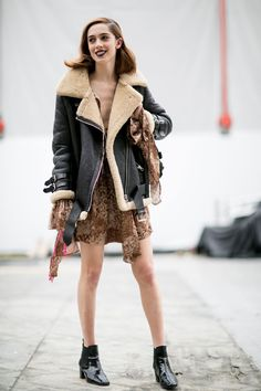 Black leather moto jacket with sherling and a cute dress. Paired with booties for a perfect fall outfit! ~ The Best Street Style Outfits at Paris Fashion Week Fall 2016 New Street Style, Model Street Style, Street Style Trends, Autumn Street Style, Cool Street Fashion, Street Style Looks, Star Fashion, Paris Fashion, Fashion Outfits
