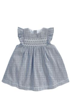 Mamas and Papas Baby Girls Stripe Smock Dress A cute and classic shape, this baby girls stripe smock dress by Mamas and Papas is perfect for summer fetes. With pretty ruffle sleeves and an embroidered chest, the fine pinstripe dress is nautical-inspired in blue and white. Flaunting a full flared skirt, the smock is light and cool for sunny weather, while a smooth cotton lining is kind to delicate skin.Washing Instructions: Machine Washable