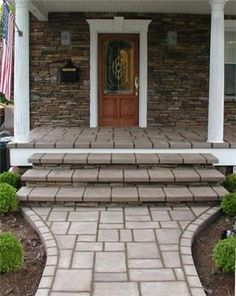 Stamped concrete steps and entryway stamped to resemble traditional style pavers.  Unique Concrete West Milford, NJ