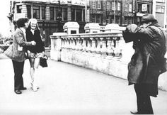 Street photographer on O'Connell Bridge (1960s)# [#>The platforms suggest this is more likely early '70s!] - This man was amazing. I've actually used him as a character in a book about old dublin and the tenements.