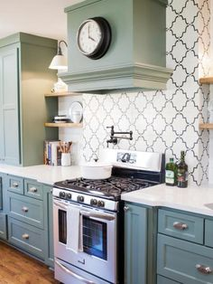 Gray-green cabinets and black and white backsplash. Also brick pavers painted white on other side for backsplash.