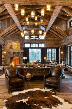 The sitting room is perfect for family or for entertaining western style. Love the cow hide rug!