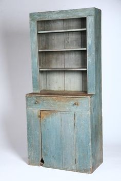 """***STEPBACK CUPBOARD.   Probably New England, 1st half-19th century, pine. Diminutive one-piece open top cupboard. One long drawer over a single two-board plank door, beaded openings and plate grooves. 75""""h. 33 3/4""""w. 17 1/2""""d. Love the mouse hole!!"""