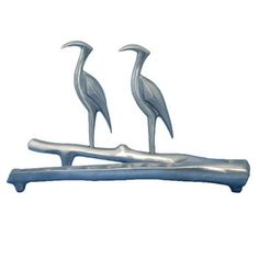 This Hanukkah menorah by Shrarga Landesman is a beautiful work of modern Judaica art. Shraga is Using very simple and organic lines, pewter and aluminum with a soft brushed finish, he depicts images of nature and animals long gone.