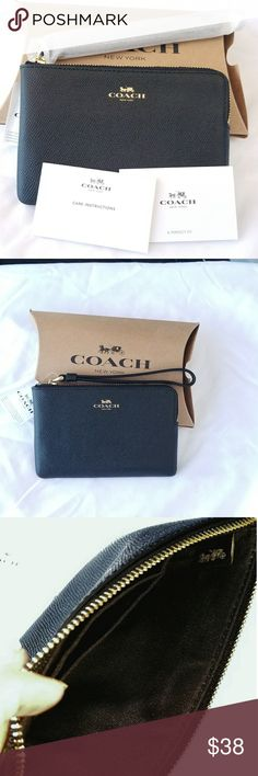 "NWT Coach Crossgrain Leather Corner Zip Wristlet This is a brand new with tags Coach black crossgrain/ textured leather wristlet with gold hardware. It measures approximately 4"" high and 6.25"" in length. The black fabric interior has two credit card slots and fits any smartphone, plus keys, lipstick, etc. Coach Bags Clutches & Wristlets"
