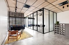 Built by Clare Cousins Architects in North Melbourne, Australia with date 2013. Images by Lisbeth Grosmann. Through the combined effort of its new occupants; a construction company and an architecture studio; this 1970's offi...