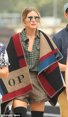 High-end versus high-street: Olivia Palermo is lucky enough to have a monogrammed Burberry...