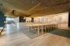colorful hues line the walls of kengo kuma-designed pigment arts store in tokyo