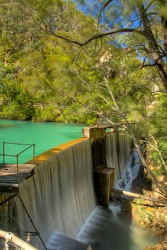 """Waterfall at the end of the """"Blue Lake"""", near the entrance to the Jenolan Caves, Blue Mountains NSW"""