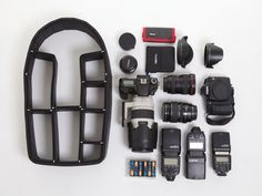 Camera backpack with configurable compartments, patent-pending pin system built into an organizer that's retrofitted to a regular backpack or hard case this is brought to you by TrekPak