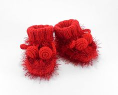 Knitted Baby Booties  handmade cost $18.00, but often it's cheaper to buy than to make...these are adorable!