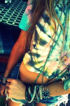 Ripped shorts, tie dye crop shirt, stacked jewelry. A classic, comfortable festival combination!