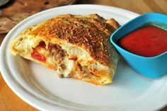 Calzones from A Duck's Oven. Homemade calzones stuffed with all of your favorite pizza toppings and dipped in tomato sauce!