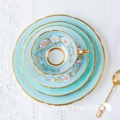 Exquisite hand-decorated Royal Stafford cabinet teacup QUAD in the pattern name Garland. The set consists of one cabinet teacup, saucer, tea plate and salad or luncheon plate in matching pattern. All pieces have no chips, cracks or crazing. There are wear / cutlery marks to surfaces,