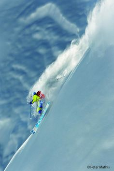 Sascha Schmid floating on fresh powder in Lauterbrunnen, Switzerland