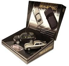 Scalextric James Bond New Film Aston Martin & chase car - ToyTrade. Slot Car Racing, Slot Cars, Skyfall, Aston Martin Db5, Chasing Cars, Old Toys, Range Rover, James Bond, Vintage Toys