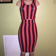 Black and Red Two Piece Black and Red striped two piece skirt set. Crop top with matching midi skirt. Skirt can be risen for the high waisted look. Set has never been worn, only tried on. Can fit a size small/medium (6-7) or medium/large (8-12) because of the stretch. 95% viscose and 5% spandex Other