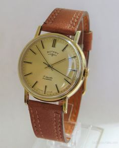 Vintage Watches Collection : Gents 9 carat gold Rotary wrist watch, 1971 - Watches Topia - Watches: Best Lists, Trends & the Latest Styles Vintage Watches For Men, Antique Watches, Rotary Watches, Wrist Watches, Men's Watches, Stud Earrings For Men, Gold Costume Jewelry, Hand Watch, Carat Gold
