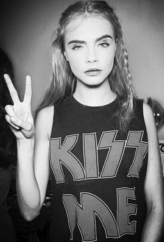 Cara Delevingne I think what I like about her is she's comes across as a real person, and she dresses a bit like a punk haha gals got style ;)
