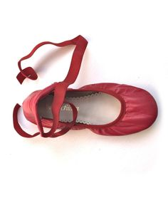 These are fashioned to look like ballet shoes - however, they are gorgeous ballet flats, with regular sole and elastic ties to tie around feet. 100% leather, made in Spain. Run small.