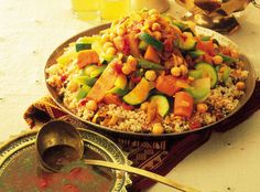 A hearty veggie stew with couscous. Couscous is the staple food of much of North Africa, where it is often served topped with tender, colourful vegetables, drenched in delicious gravy and spiced with a traditional hot chilli sauce called harissa. Iftar, Couscous Party, Couscous Ideas, Couscous Sans Gluten, Easy Healthy Recipes, Vegetarian Recipes, Moroccan Couscous, Moroccan Stew, Healthy Family Dinners