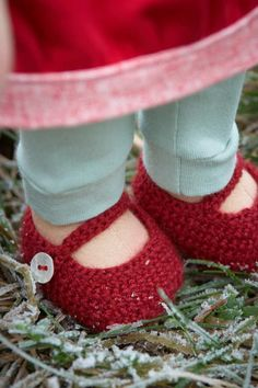 Kiki's crochet shoes. Those tiny stitches, those beautiful mother of peal buttons, those mint leggings…all that red!