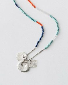 Instantly elevate your look — and your mood — with this handmade necklace. Exclusively for us, it boasts an impressive length, a trio of captivating charms, and a cool color-blocked collection of stones.