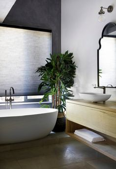 Tropical modern bathroom with freestanding bath and large indoor plant and concrete tiles. #timbervanity #floatingvanity #modernbathroom #resortbathroom #concretewall Large Indoor Plants, Timber Vanity, Freestanding Bath, Floating Vanity, Concrete Tiles, Modern Bathrooms, Sunshine Coast, Sustainable Living, Tropical