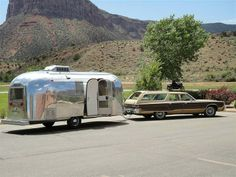 Vintage 1966 Airstream Safari with station wagon. 1966-68 were the best years for Airstream, IMO. The Corning Glass windows fit the curve of the shell and are flush with it. Very clean line.