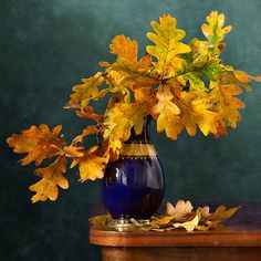 Oak Leaves http://nikolay-panov.artistwebsites.com/products/oak-leaves-nikolay-panov-art-print.html • Floral still life with oak yellow leaves in blue vase in autumn