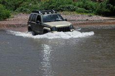 Lifted Jeep Liberty offroad Renegade Water Crossing off road.  KJ, KK