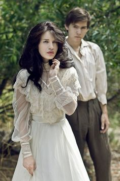 our first picknic to the woods, i was wearing my wedding dress, it was simple, long sleves and plain fabric from the waist f=dwon, but the top was lacey and layered, he stood behind me in his lo cut, dirt white c=bloiase. i couldnt have imagned a better eddding