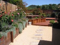 Wood retaining walls with Coral DG and step stones