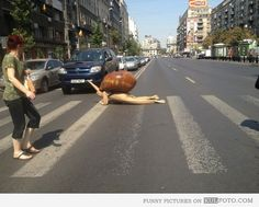 Cosplay: Snail - Guy in funny snail costume crawling on a crosswalk in Romania -- funny cosplay.