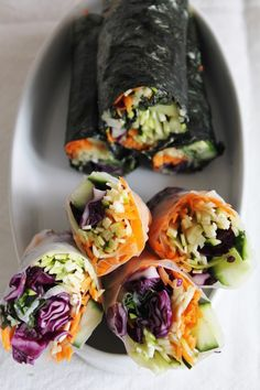 raw nori wraps with red cabbage, cucumber, carrots, zucchini and spicy dipping sauce.