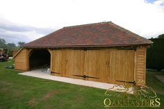 Oak Garages  Outbuildings - 901: Timber garage. A bespoke oak framed garage with two closed bays and one open bay.