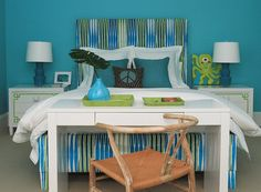 Love the idea of the desk at the end of the bed! Sometimes a great space saver!  The bedside lamps are  playful and cute in this room!