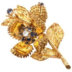Tiffany & Co. Diamond Sapphire Yellow Gold Opening Flower Brooch | From a unique collection of vintage brooches at https://www.1stdibs.com/jewelry/brooches/brooches/