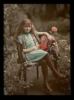 Edwardian girl. Not sure if it is tinted or an autochrome