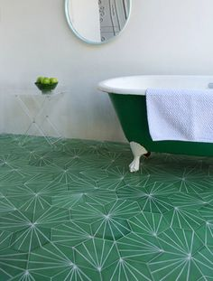 Green tile is trending in interior design. Here are 35 reasons why we can't get enough green tile. For more interior design trends and inspiration, visit domino. Contemporary Tile, Hexagon Tiles, Geometric Tiles, Hex Tile, Bath Tiles, Mosaic Tiles, Geometric Shapes, Tiles Uk, Wall Tile