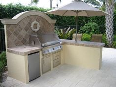 Solaire built in infrared gas grill outdoor kitchen with built in drawers and refrigeration.