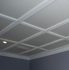 Drop ceiling that looks like coffered ceiling. No instructions at link except it is crown moulding.