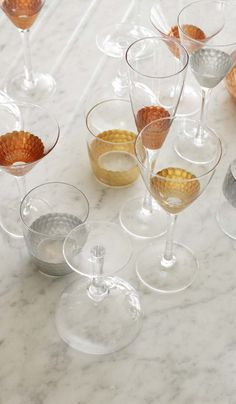 Mix your metals with our Set of Four Mixed Metallic Wine Glasses.