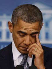 President Barack Obama wipes a tear as he speaks about the shooting at Sandy Hook Elementary School in Newtown Ct.