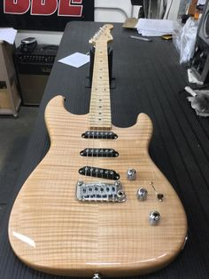 Here's an Deluxe in Natural Gloss over flame maple on swamp ash, DFS Vibrato (stainless saddles and 1018 cold rolled steel block), birdseye maple neck with Clear Gloss finish. G&l Guitars, Birdseye Maple, Musical Instruments, Musicals, Cold Rolled, Saddles, Natural, Electric, Artists