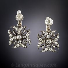 Antique Diamond Maltese Cross Earrings. Although dating from the mid-to-late-nineteenth century, these dramatic dazzlers would fit right in to a contemporary hipster boutique. Handcrafted in darkened silver over 9K gold, hence most likely of British origin, the Maltese crosses sparkle with over 2 carats of antique cushion-cut diamonds, and dangle from a single collet-set old mine diamond added at a later date