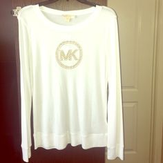 New with tags long sleeve MK top. New with tags long sleeve white and gold MK top. Soft to the touch. 53% polyester and 43% rayon. MICHAEL Michael Kors Tops